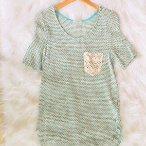 Blue sweater tee with crochet pocket
